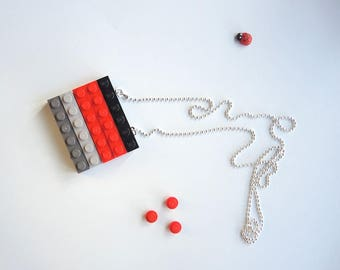 Long pendant made of coloured plastic bricks, gray, red and black