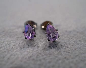 vintage sterling silver stud earrings with pear shaped faceted amethyst stones in a prong set setting   M4