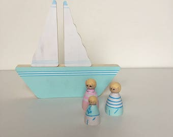 Fitted wooden play sailor and boat