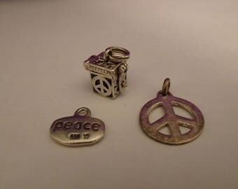 Three Sterling Silver Peace Charms