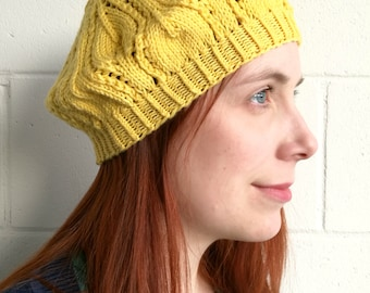 Yellow light beret for women. Women's hat with leaf pattern.