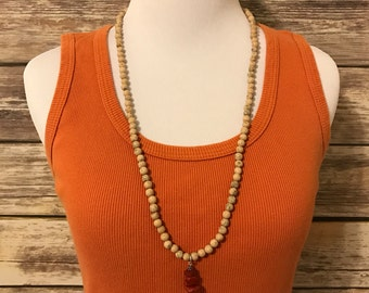 30 inch hand beaded natural stone necklace with arrowhead pendant in Clay
