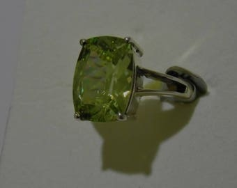 Beautiful Zircon like Lime Green Gemstone set into a solid Silver ring