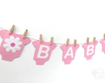 Pink BABY Banner with flowers, baby bodysuit, romper shape. Baby girl, New Baby, Party Bunting, Photo prop. Floral Baby Shower Banner.