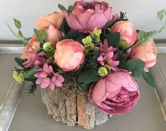 Summer flower arrangement with dusky pink peonys greenery and moss. Silk flowers.