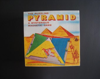 The Puzzling Pyramid. A Mysterious Magnetic Game. 1960 vintage board game from Schaper Games.