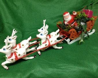Vintage flocked sleigh with plastic santa and reindeer