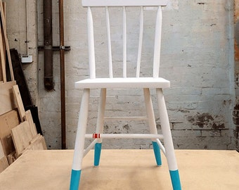 White vintage chair with paint-dipped feet