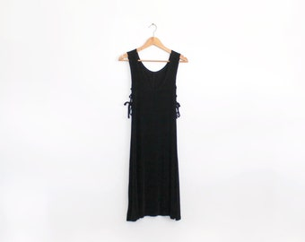Minimal 90s black slinky midi dress with low arm holes and tie sides