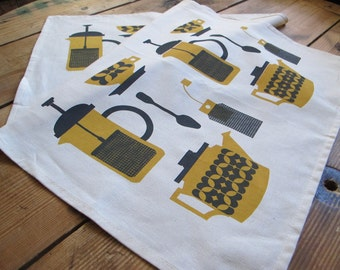Screen printed tea party tea towel in mustard and grey