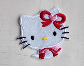 5.9 x 5.5cm, Sailor Hello Kitty with Bow Iron On Patch (P-020)