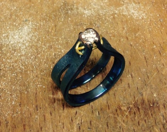 Titanium ring with gold and diamond