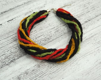 Hand felted etno necklace, black, red, green, yellow