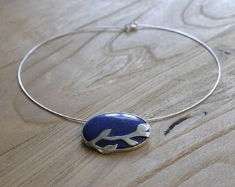 Lapis Lazuli pendant with silver details.