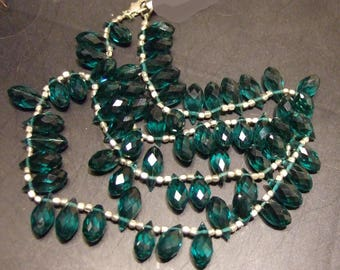 """Necklace,  clear faceted green tear drop crystal glass  18"""".  Beads are 6x12 mm."""