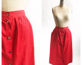 Red cotton midi skirt with metal buttons and pockets. Size S/M.