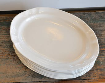 8 Big beautiful vintage Ironstone platters - could be used for serving or for a really special plated meal. No makers marks.
