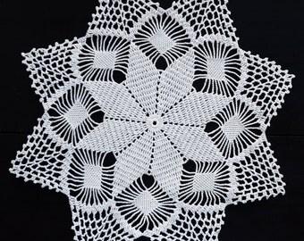 White vintage crochet star doily