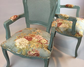 Cottage style painted upholstered floral armchairs