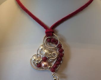 Ruby and shell pearl wire wrapped heart on a suede cord