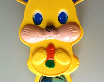 Vintage pull string musical toy rabbit rare collectibles crib yellow music box seventies peek-a-boo baby soother retro collectable