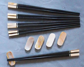 Handmade Ebony Chospsticks with Brown Abalone Shell accents and matching rests. Set of 5)