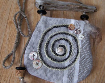 Talisman pouch with the spiral as a symbol embroidered on it in bright colors, and is actually to transfer the neck