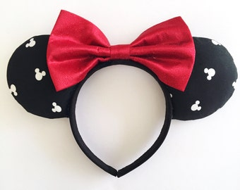 Black and White ears with a Red Sparkly Bow