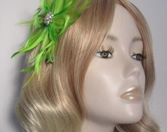 LIME GREEN FASCINATOR, With hackle and biot Feathers, crystal detail, on a comb.