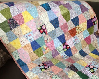 Tumbler block lap quilt in scrappy multi colors, quilted with feathers, crib size quilt or can be used as a table cloth or picnic blanket