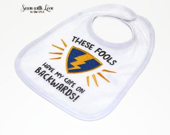 These Fools Have My Cape On Backwards Embroidered Bib | Funny Bibs | Baby Bib | Gifts Under 10 | Baby Gift | Baby Boy | Baby Accessories