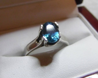 Cambodian Blue Zircon.  Top color in an 8 x 6 mm oval weighing 2.25 ct and set in .925 Sterling Silver.  Size 6.5 US but can be sized.