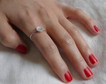 Narrow silver ring with circle