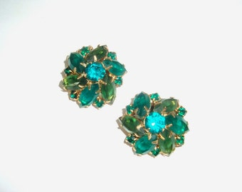 """Vintage multi stone clip on earrings. Green and blue glass rhinestones are prong set, marques and round. About 1"""".  In good used condition."""