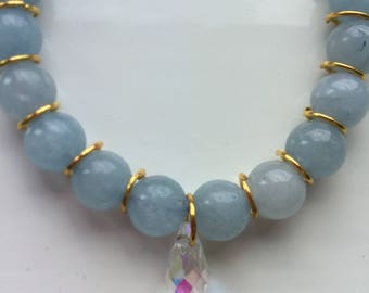 Amici. Gold and light blue natural beaded bracelet