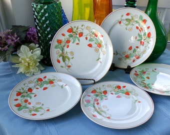 Set of 4 vintage Avon Strawberry luncheon or dessert plates. Fine porcelain hand painted with 22k gold trim. Collectible china made in 1978.