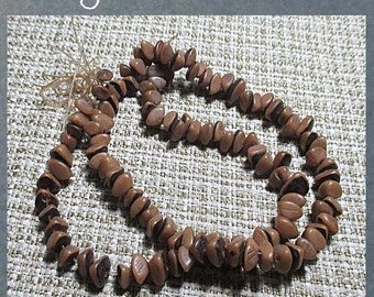 """BURI PLANT SEED beads - natural color - 1/4 crescent slices - w/ skin intact - 15"""" strand"""