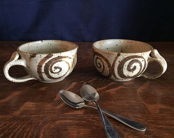 Handmade pottery mugs Pair of large vintage ceramic coffee cups with brown swirls on cream background