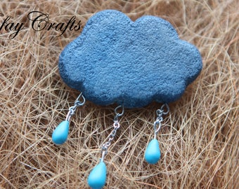 Brooch gray-blue cloud with raindrops