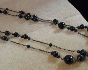 Necklace chains and balls of black wood