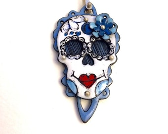 Enameled Sugar Skull necklace with enameled background on silver rolo chain