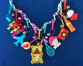 Totally Awesome Vintage 80's Plastic Bell Clip Toy Charm Necklace Jewelry w/ Camera, Headphones, Airplane, Tennis, Telephone, Hot Dog, Soda