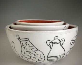 White and Orange Nesting Bowls with Kitchen Utensil Sgraffito Drawings