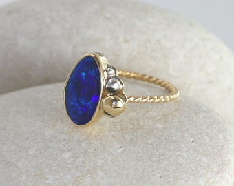 14Kt Gold Opal Ring with Thin Twisted Band, Gold and Silver Accents, and Deep Blue Opal Stone