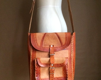 WEEKEND SALE! vintage 70's saddlebag / hand tooled leather  / braided leather /  bohemian bag / cross body tote  / hippie / warrior motif
