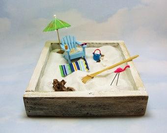 miniature zen beach garden kit, miniature adirondack chair, sunglasses, pink flamingo, bucket, beach towel, beverage