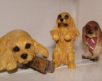 Spaniel Dog Figurines, A Group of 3