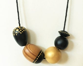 Sunspot Necklace - Black, Gold Polka Dots and Natural Wood Grain Beads - Dotted by Hand
