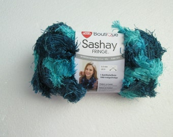 Red Heart Boutique Sashay Fringe yarn in SURF color