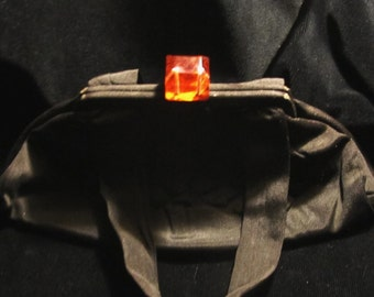Art Deco evening bag with lucite clasp